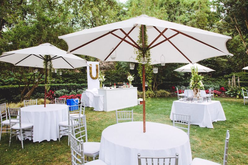 SITTING PRETTY: Loluma set the outdoor tables with white linens and Chiavari chairs—a clean and crisp that balanced well with the colorful flowers and natural elements.
