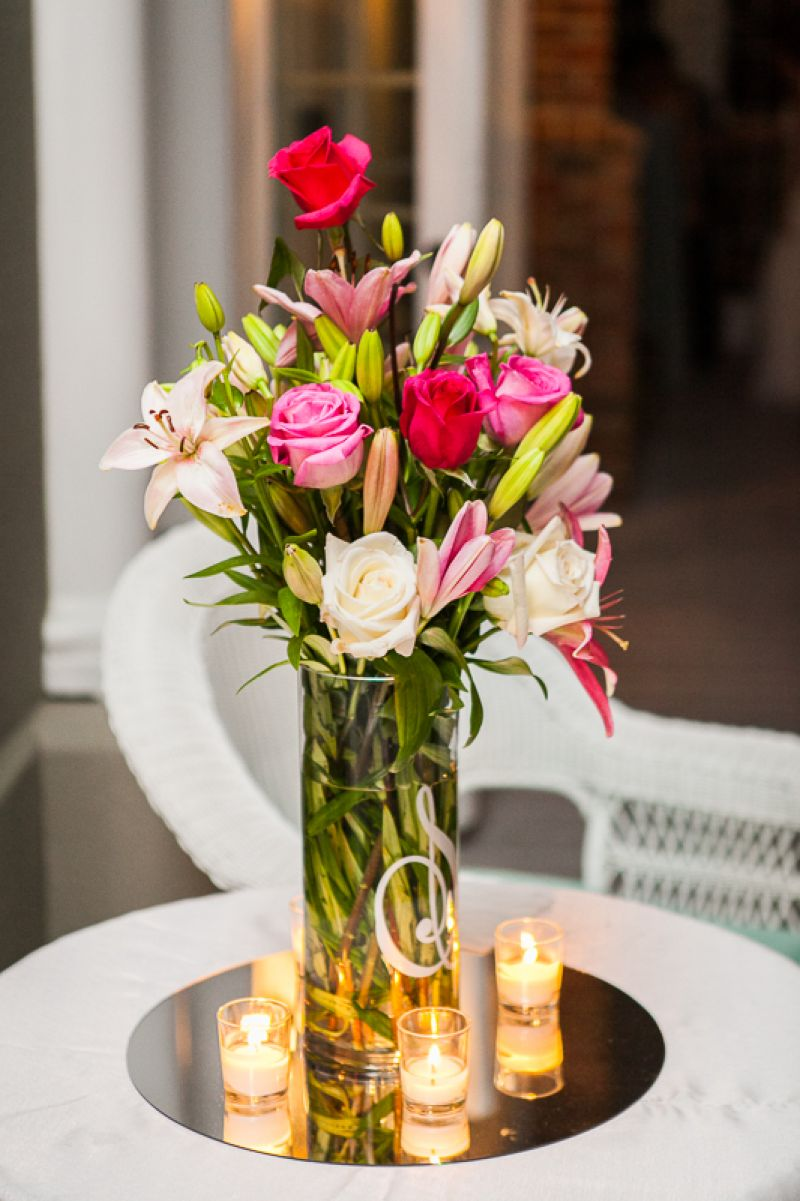 """blush and bashful."" The formal floral arrangement at the church's entrance featured a blush array of roses"