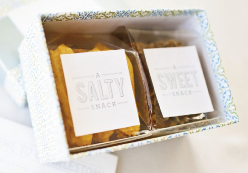 CRUNCH 'N' MUNCH: Welcome boxes filled with cheese straws from Hamby Catering were wrapped in cheery blue paper and hinted at the event's colors.