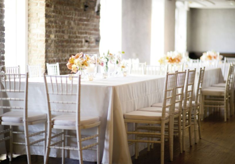OPEN INVITE: Tone-on-tone white and ivory furniture and linens allowed sweet clusters of peach, melon, and orange flowers to stand out.