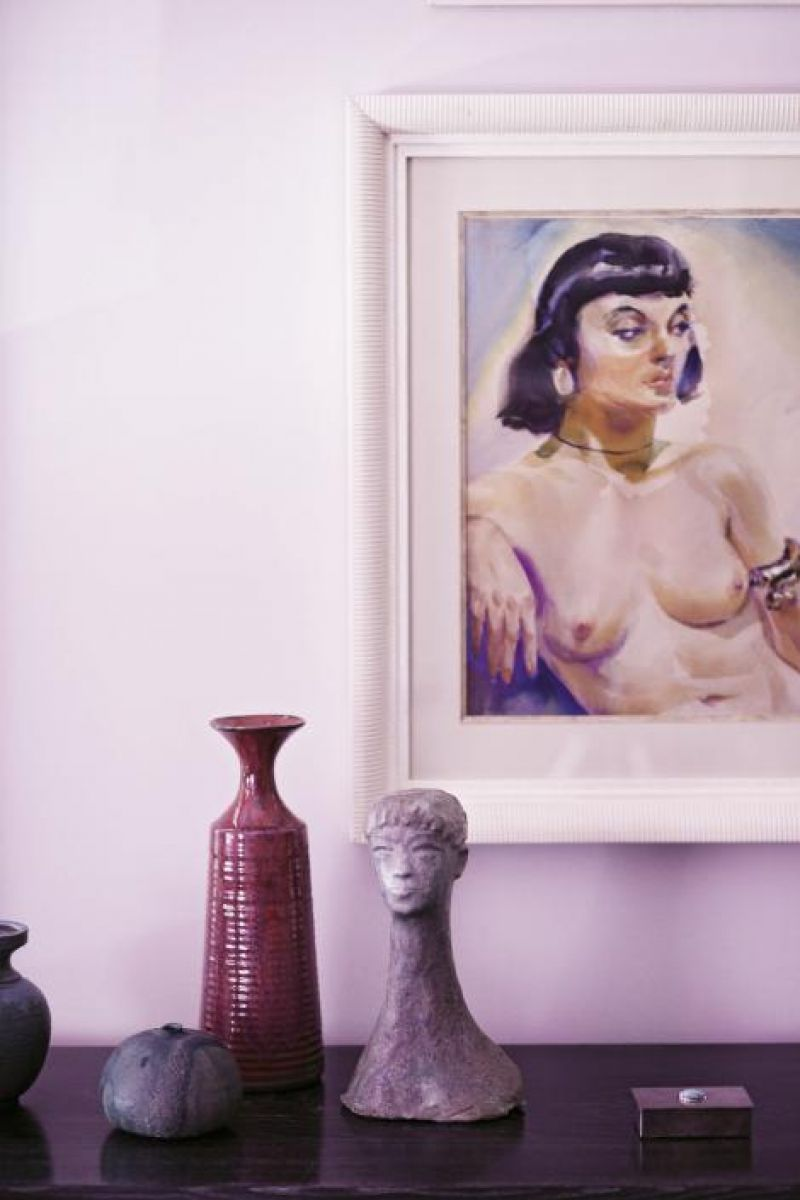 A 1950s South American painting and assorted pottery.