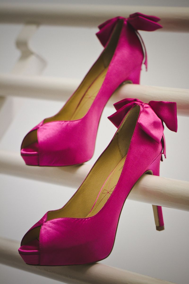 IF THE SHOE FITS: Marissa's satin Pour La Victoire pumps complemented the day's palette of gold, black and fuchsia (the bride's favorite color).