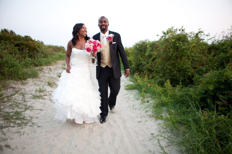 "SURE OF THE SHORE: The couple says choosing the reception venue was simple: ""We both love the beach, with the bride being raised in Charleston and the groom being of Jamaican ancestry, it was only fitting that we had a venue on the water,"" says Marissa. ""The Sand Dunes Club is one of the best beach venues in the Charleston area."""