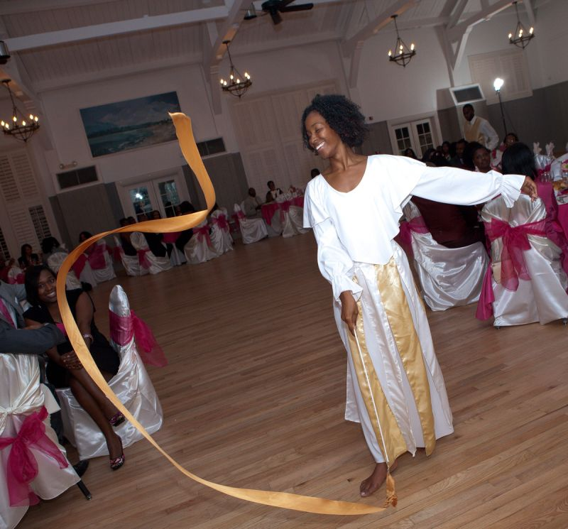 "DANCE DÉCOR: Cultural elements were weaved in throughout the day. ""The overall feel of the day was that it was a tropical destination wedding and a family reunion all in one, without having to travel internationally,"" says the bride."