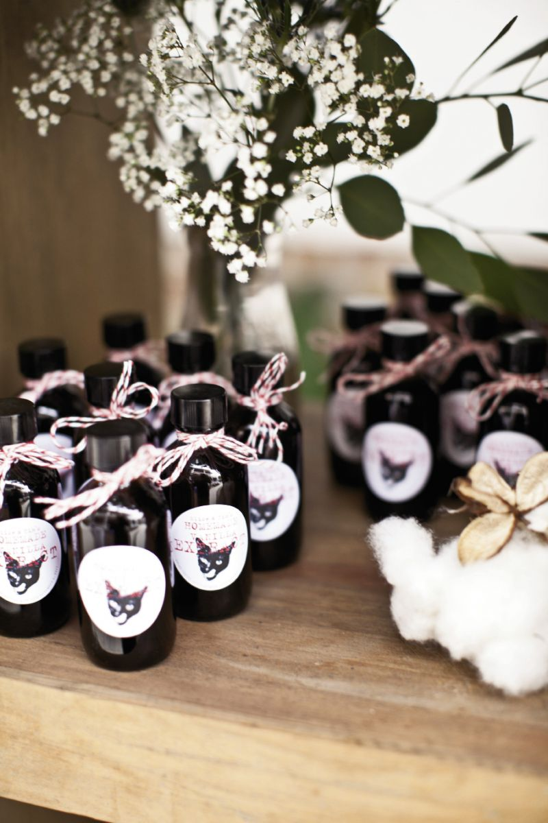 PET PROJECT: The pair made homemade vanilla extract favors and picked cotton for décor.
