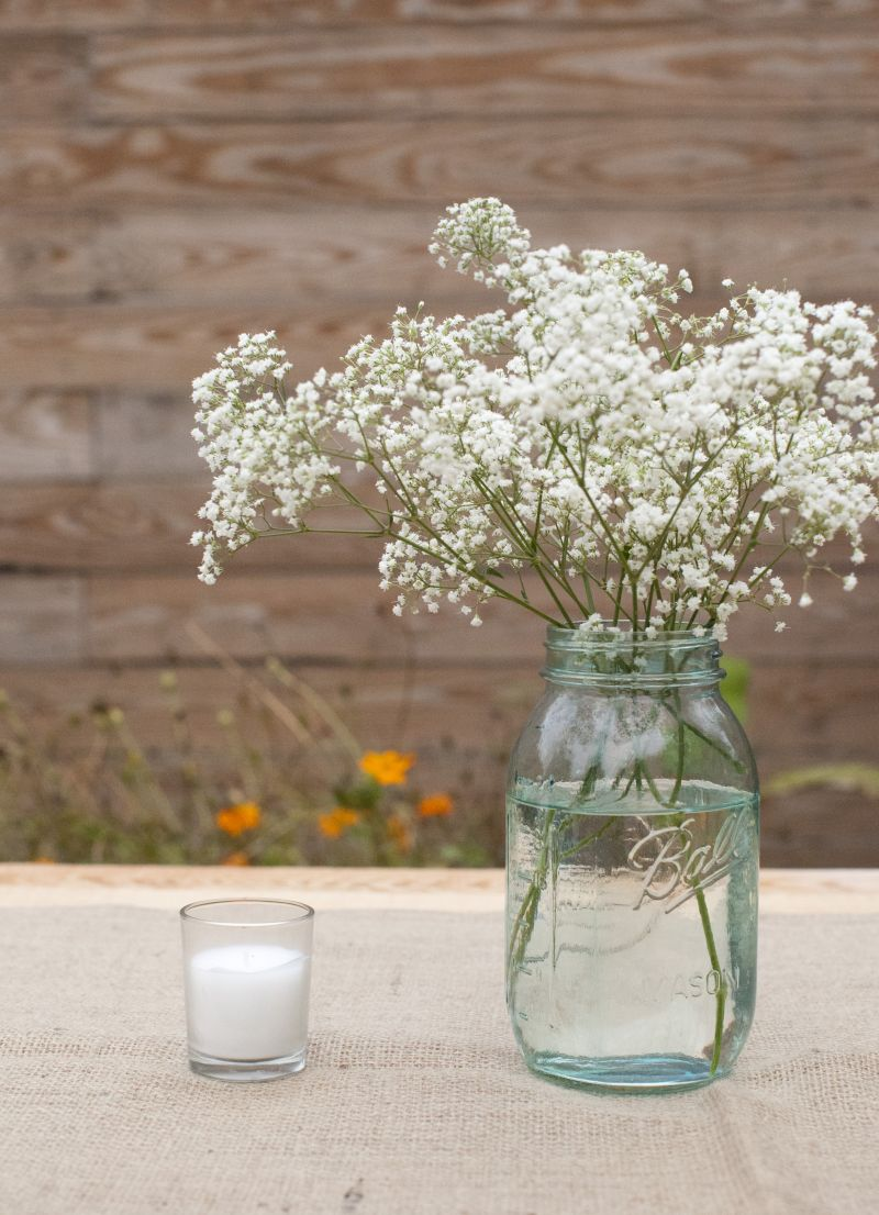 BARELY THERE: Flower arrangements were artfully spare, like baby's breath in a Ball jar.