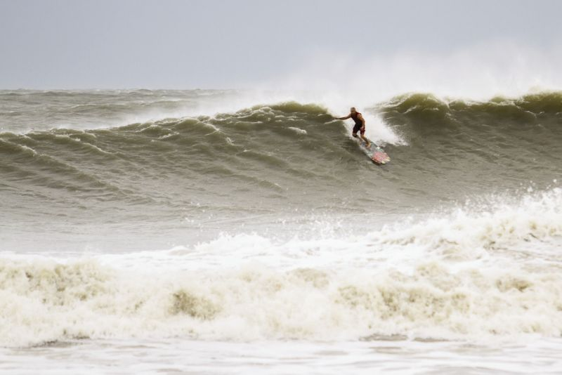 Folly Beach's hot-rod icon Paul Martin takes the drop on a wild Lowcountry wave, courtesy of Hurricane Irene.