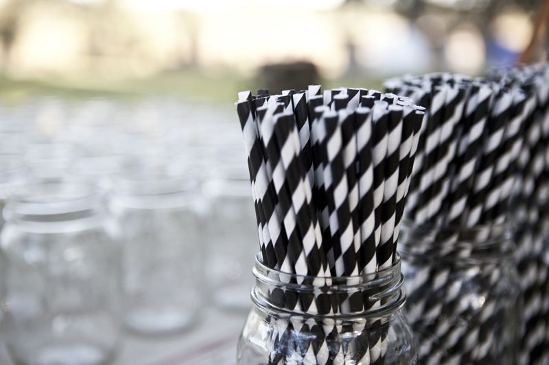 TAKE A SPIN: The black and white theme made its way to the bar setup by way of these grayscale candy cane striped straws.
