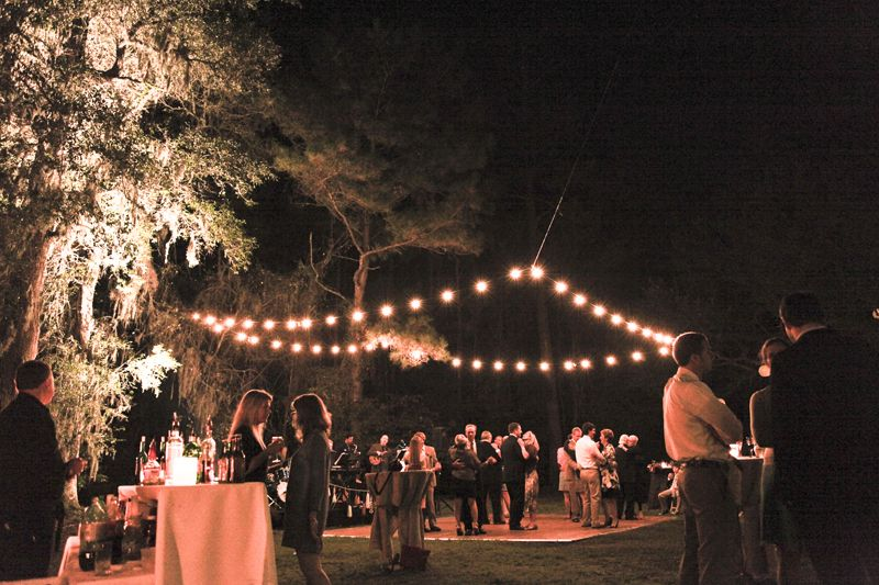 "THE WORLD'S A STAGE: Ashley says of the reception: ""John set up an amazing system in the trees over the stage and dance floor to suspend the string lights perfectly over the dance floor, just as I had envisioned."""