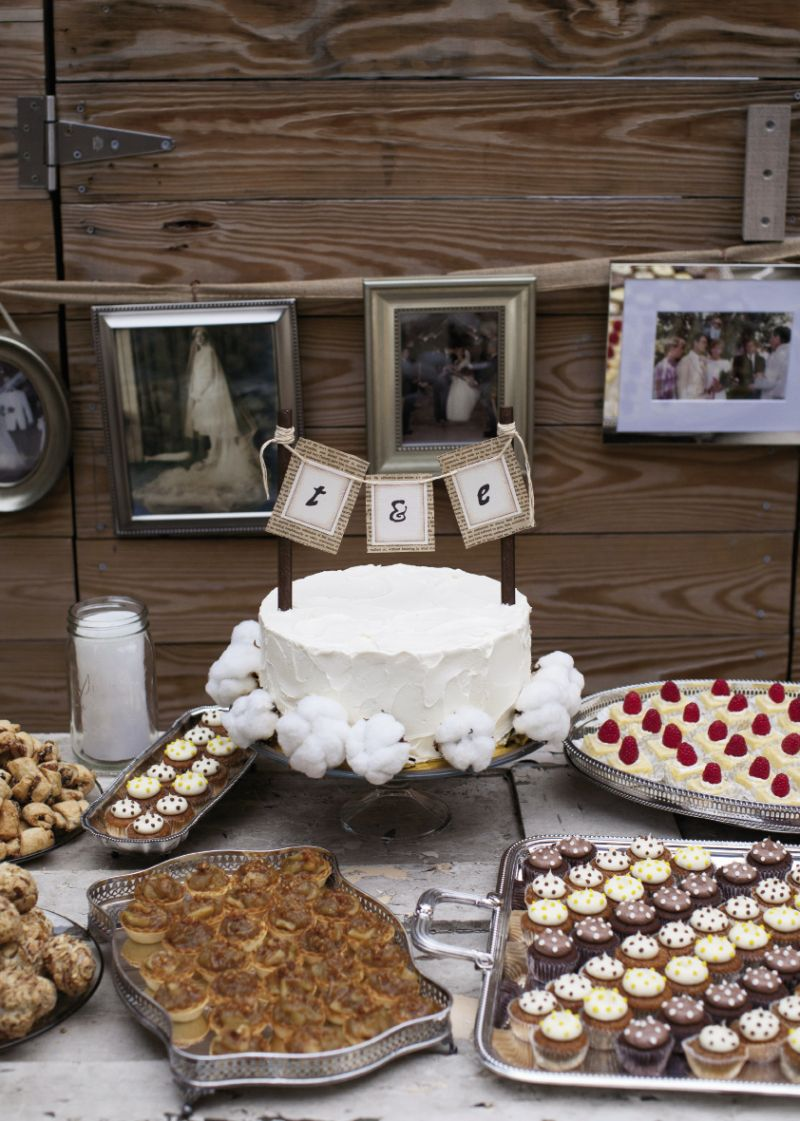 BANNER DAY: Surrounded by Twenty Six Divine treats served on silver pooled from both families, the cake wore a banner made from pages of Pride and Prejudice.