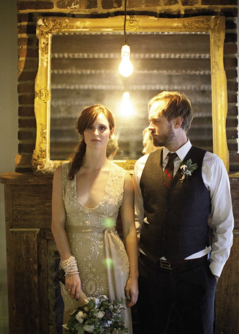 KEEP IT SIMPLE: Exposed lightbulbs and rustic wooden elements helped lend the evening its old-timey feel. The bride wore a gown from local designer Rachel Gordon. (above)