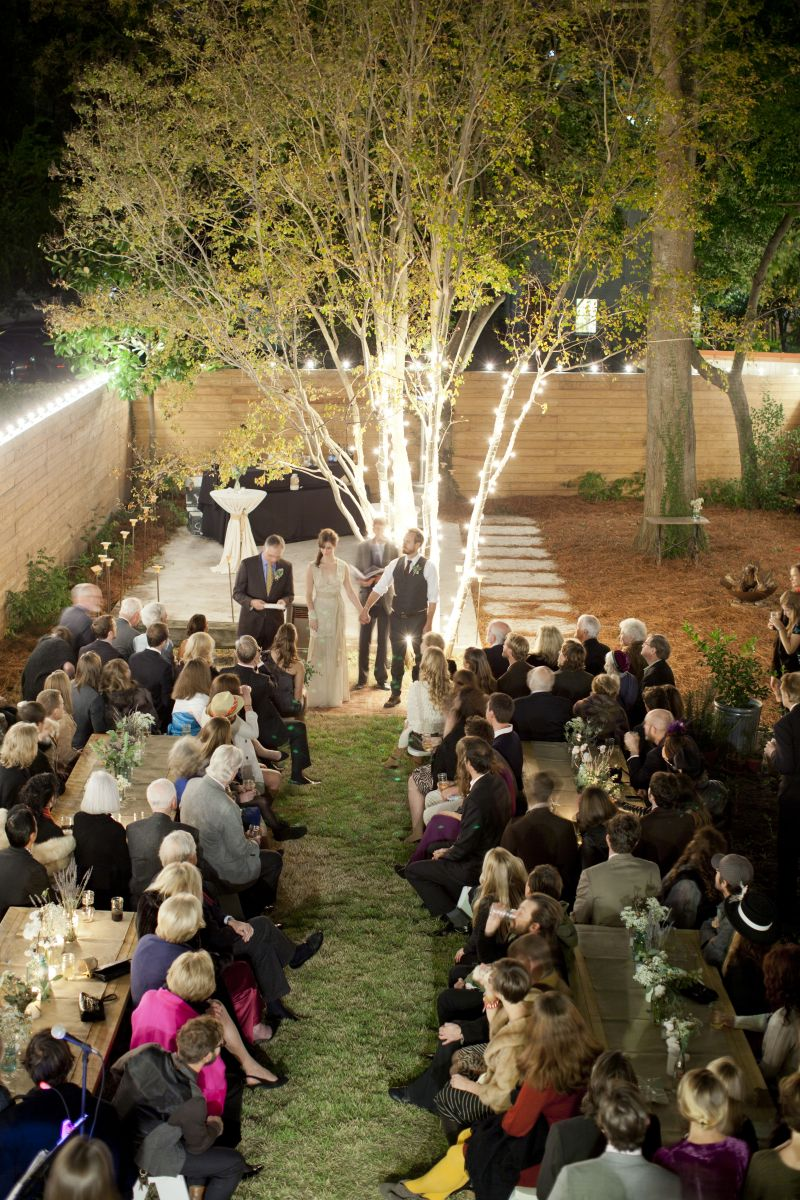 IN THE SPOTLIGHT: Bright bulbs gave the backyard a whimsical glow. A few strands were spiraled up the orange tree, focusing due attention on the newlyweds-to-be.