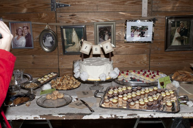 WHAT A SPREAD: In the spirit of intimacy, the couple used only silver hand-me-downs as serving dishes. The cake, baked by Twenty Six Divine, was complemented by smaller treats from local bakeries, like Saffron Café and Bakery.