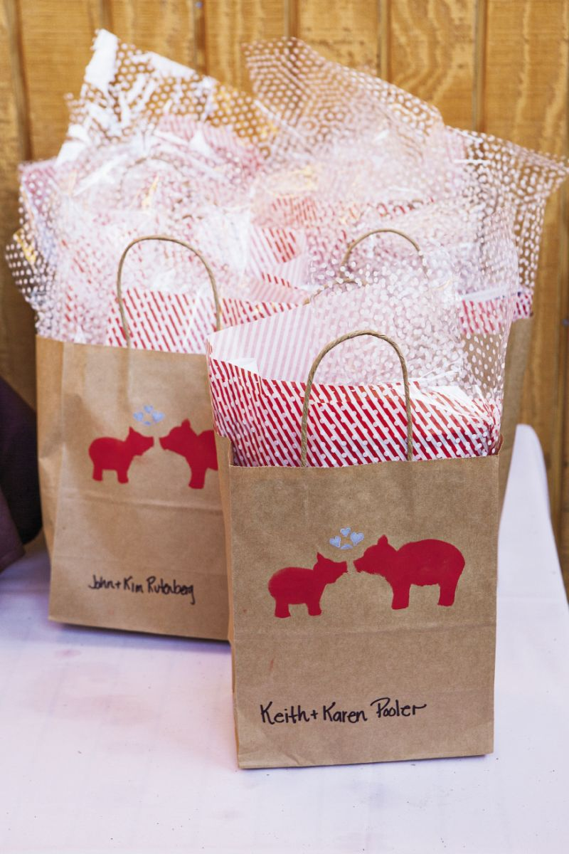 PIG IN A POKE: Gift bags for the barbecue guests were hand stamped with a smooching pair of pigs.