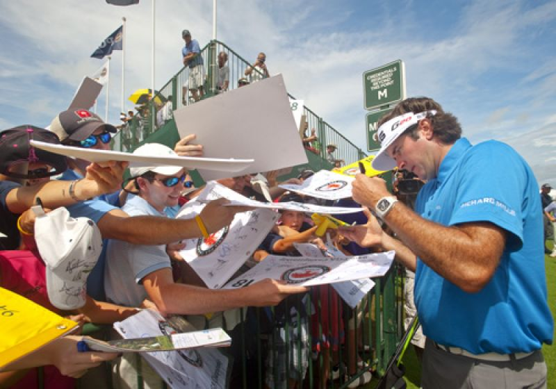Bubba Watson responded to the chants of Bubba, Bubba...with an extended signing session.