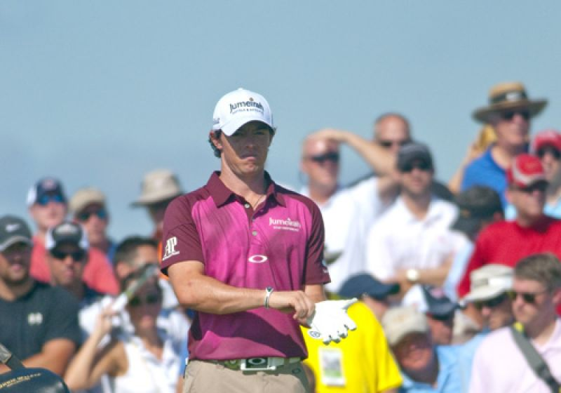 Rory Mcilroy pulls on his glove in preparing to tee off.