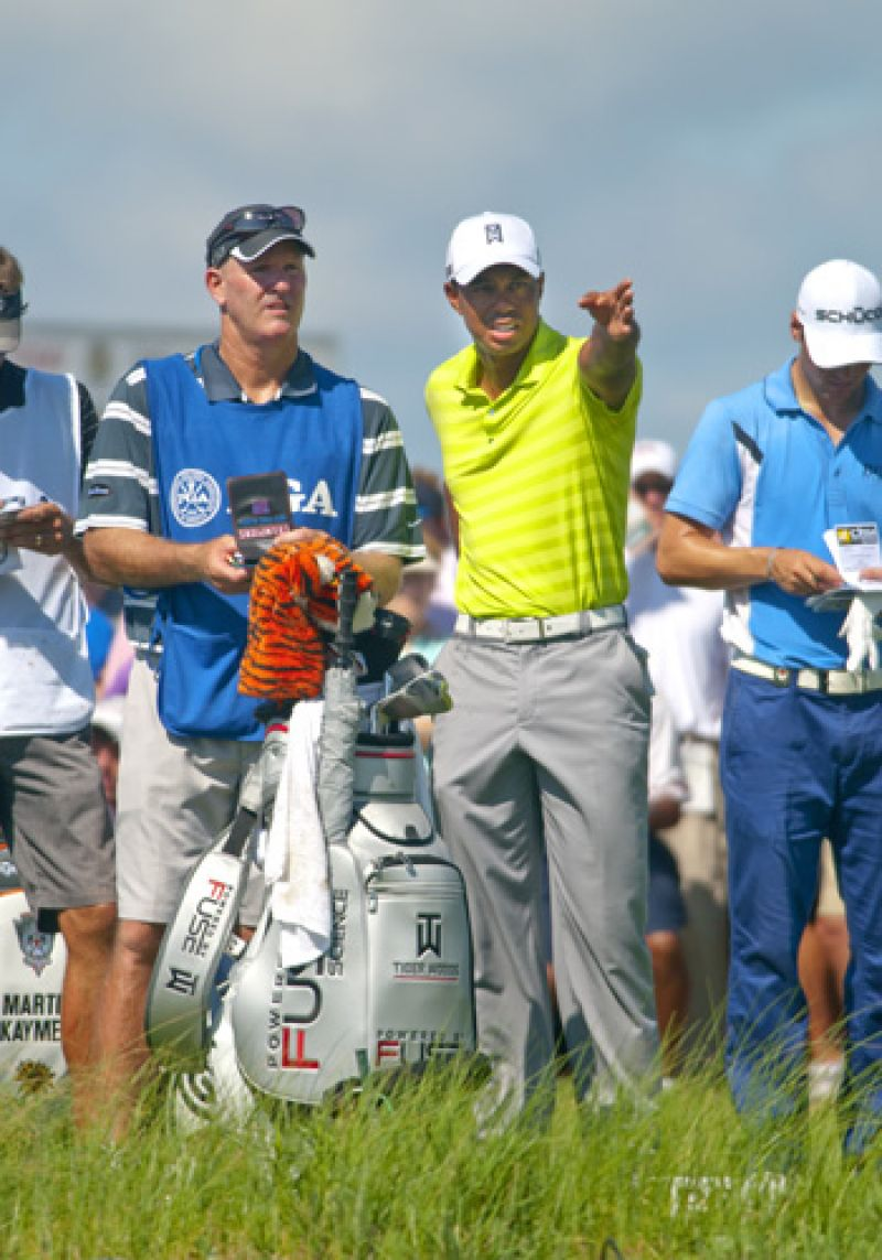 Tiger and his caddie discuss the challenging par 3 17th, the ball did not go where he is pointing.