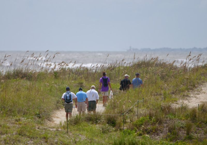 Fans taking a stroll along the dunes of the back nine.
