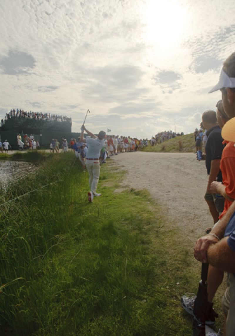 Keegan Bradley threads the needle up over the hill back onto the 11th fairway.