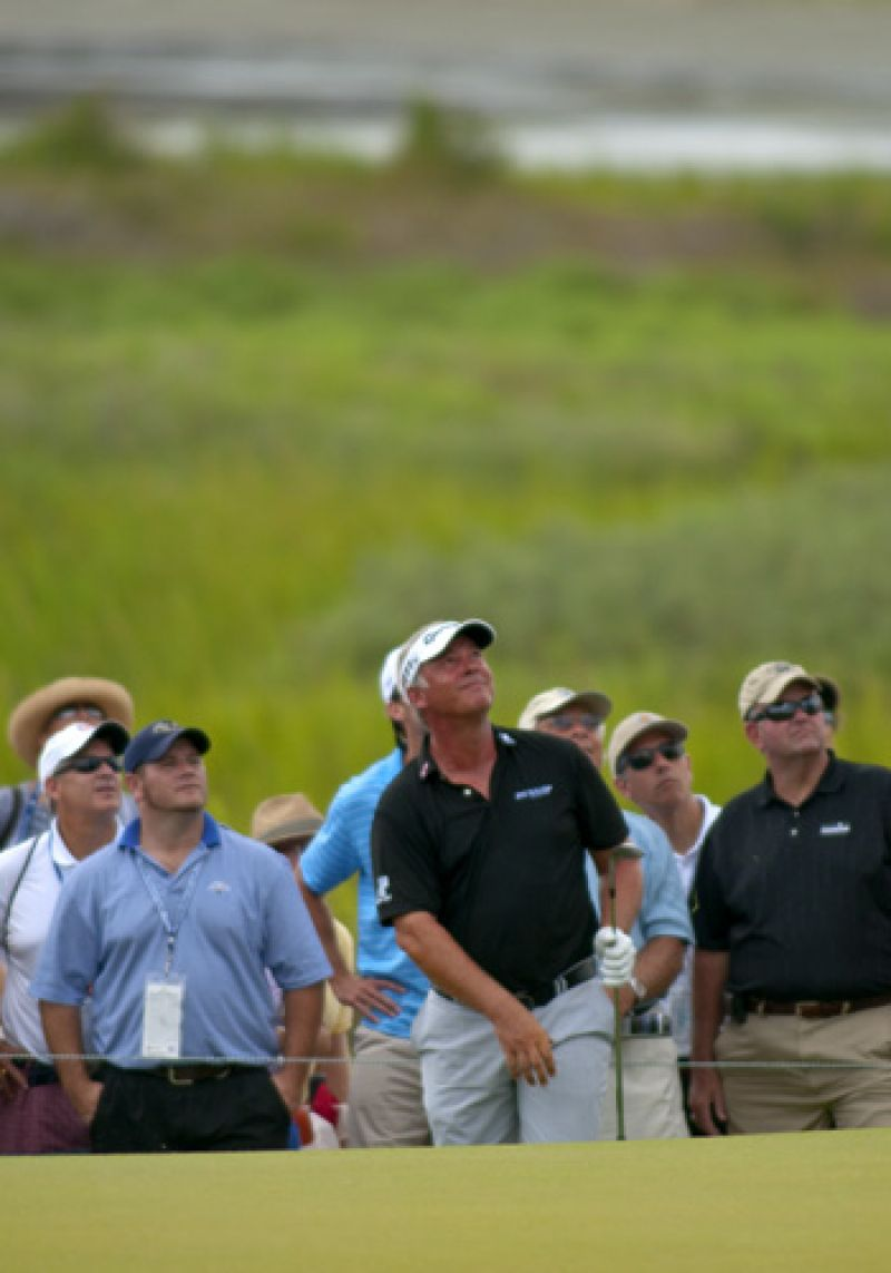 Darren Clarke and the crowd watch his ball's flight.