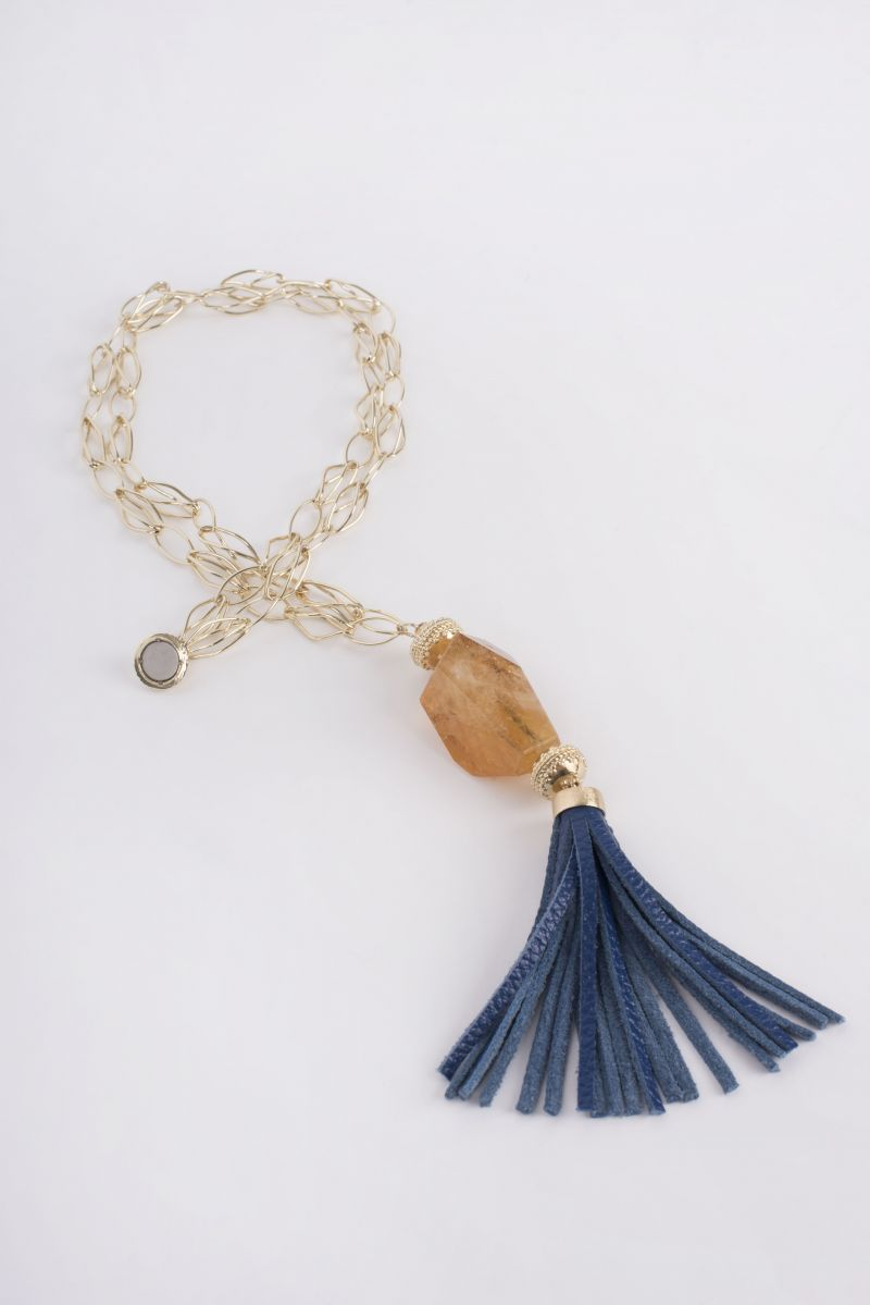 "Clara Williams 14K yellow gold plated ""Willow"" necklace with large faceted Citrine centerpiece and Royal blue pebble grain leather tassel, $1,885 at Croghan's Jewel Box"