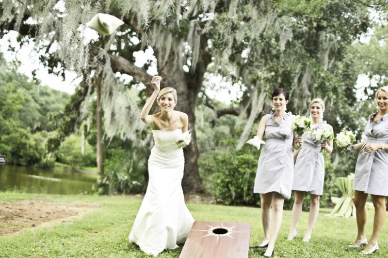 PLAY TO WIN: In keeping with the informal vibe, guests enjoyed cornhole, the bride's favorite outdoor game, during cocktail hour.