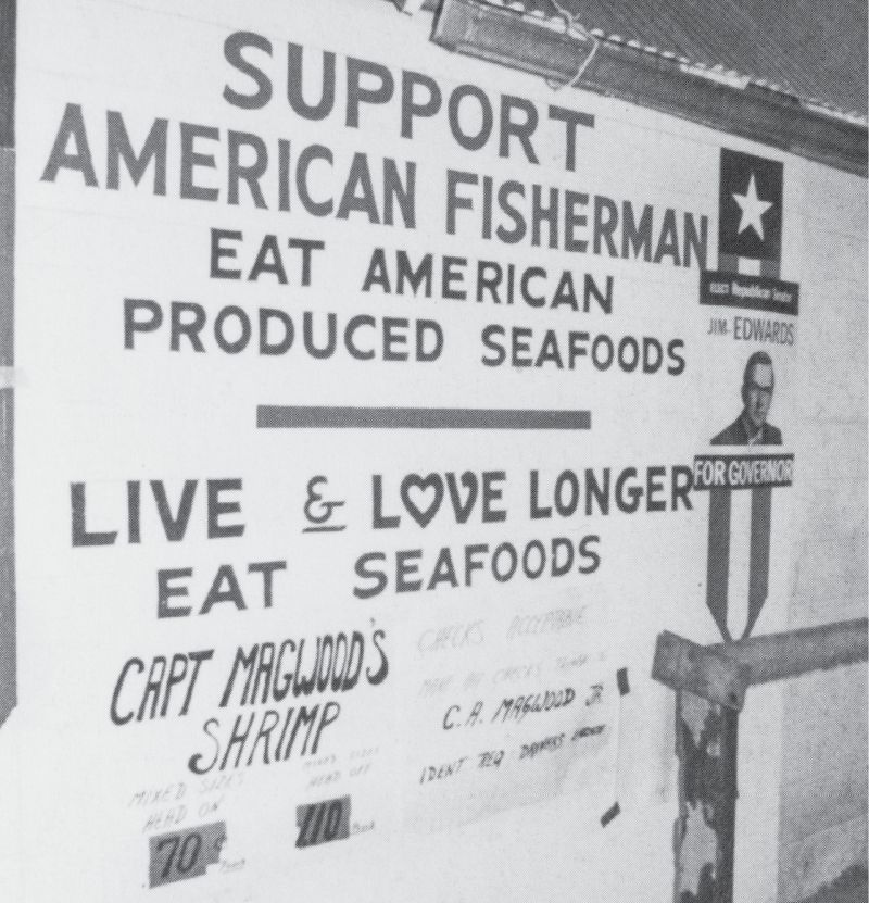 """The Magwoods have touted the """"buy local"""" slogan for decades, as evidenced by the sign at C A Magwood Jr & Sons seafood and dock."""