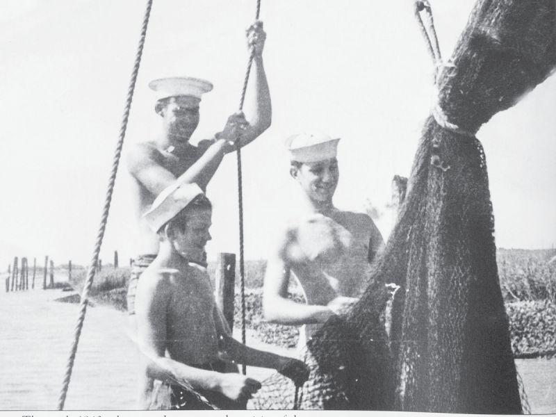 Magwood boys sewing shrimp nets circa 1940