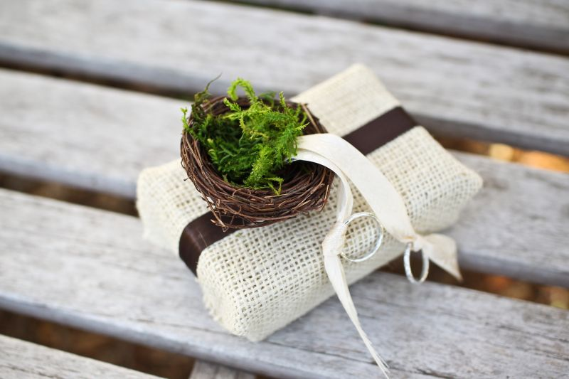 A SAFE BET: The wedding bands, delivered to the altar in a mini moss-filled nest, were secured in place by ivory ribbon.