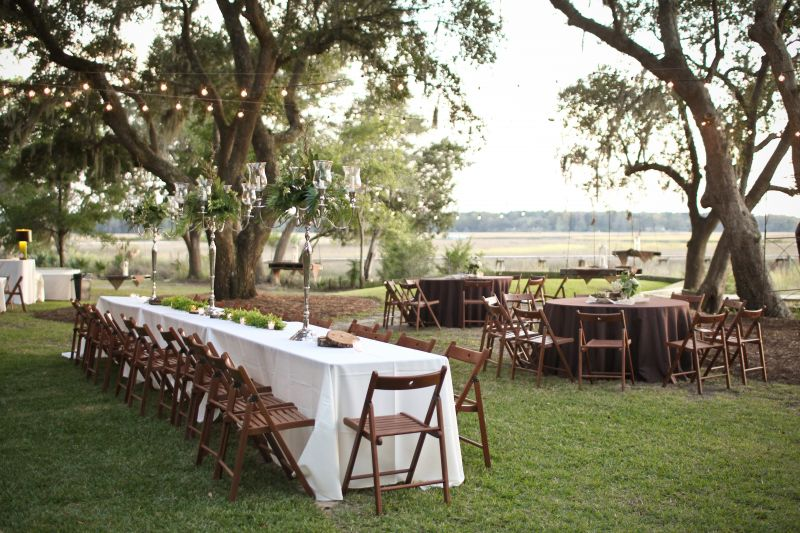 NATURE'S BOUNTY: Neutral-colored linens, wooden appointments, and green arrangements were right at home amid the backyard venue.