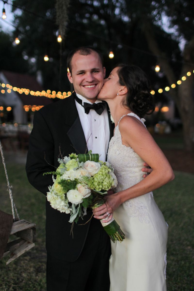 SHOW SOME LOVE: Logan wore her mother's vintage wedding gown; Mark, a classic tux from Jean's Bridal.