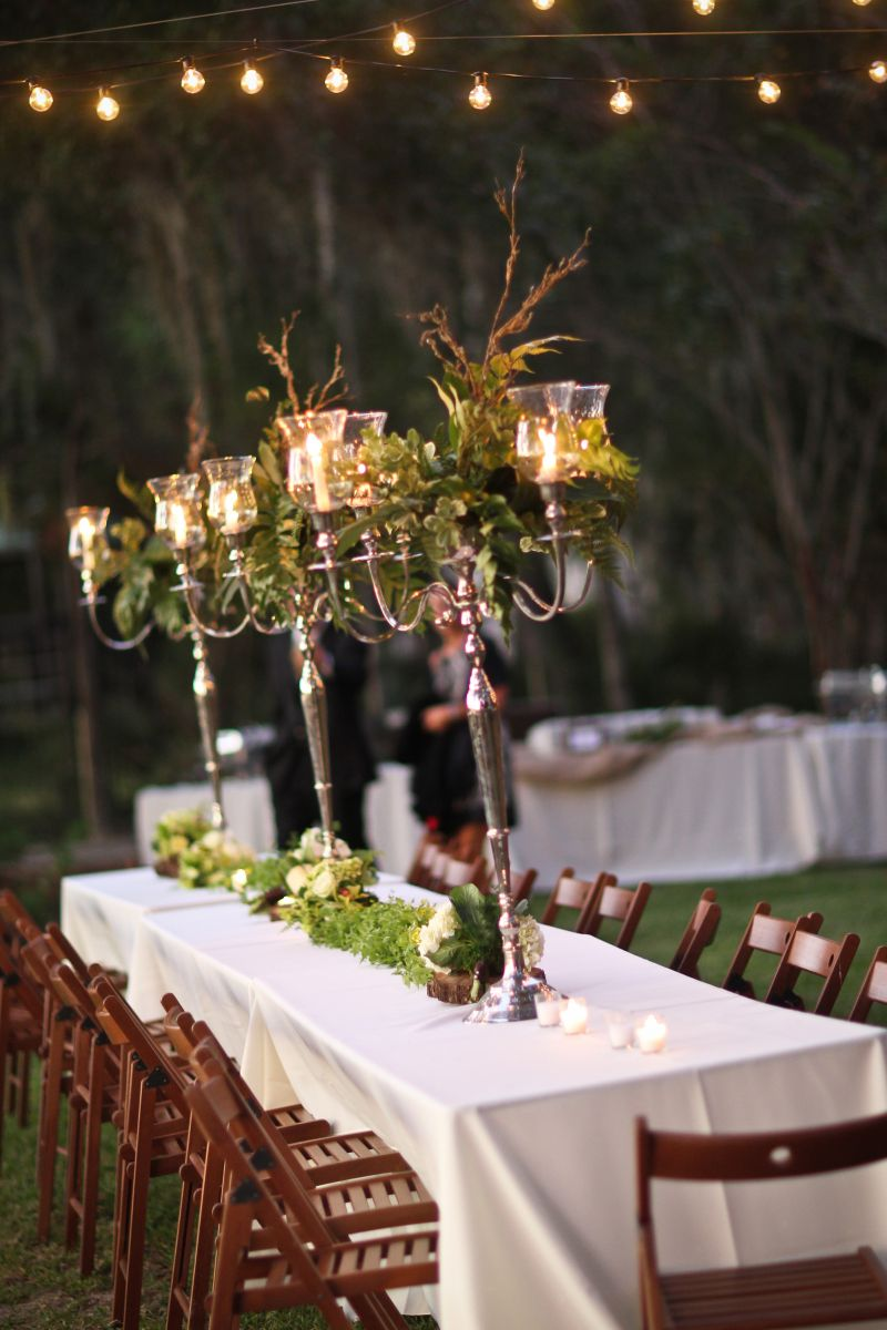 A FINE FIT: Grand candelabras holding fern centerpieces were well-suited for the open air space.