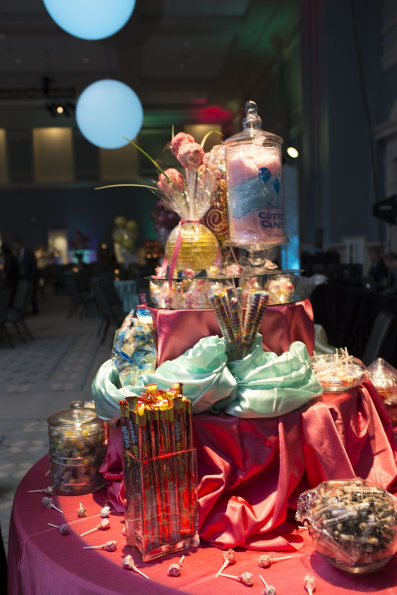 Jars of candy lined two tables letting guests have access to sweet treats throughout the night.