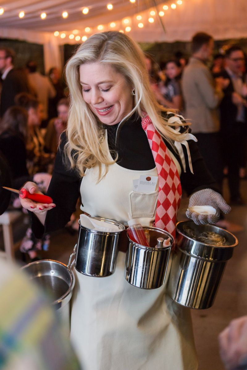 Lydia Mondavi helps guests shuck oysters