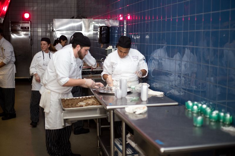 Students prepare hor d'voures in the kitchen.