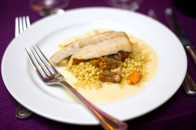 The second course featured pan-seared brazino, a tangine of vegetables, Israeli couscous, and aromatic broth.
