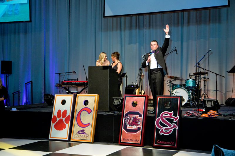 Clemson and USC cornhole boards sold at the live auction