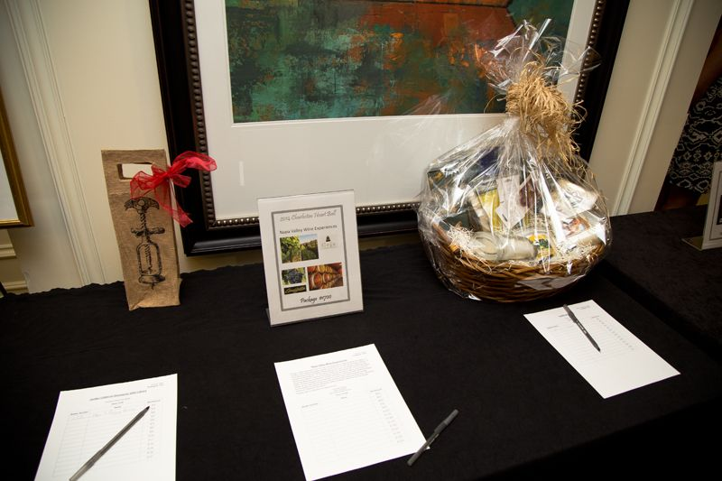 Items in the silent auction, including a Napa Valley wine tasting experience