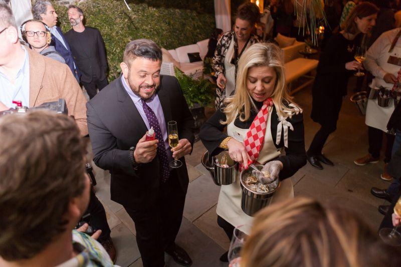 Man Vs. Food Host Adam Richman with Lydia Mondavi