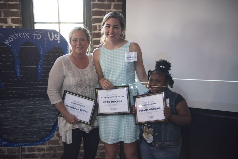 Mrs. C., Lizzie Mitchell, and Purasia Williams proudly display their awards.