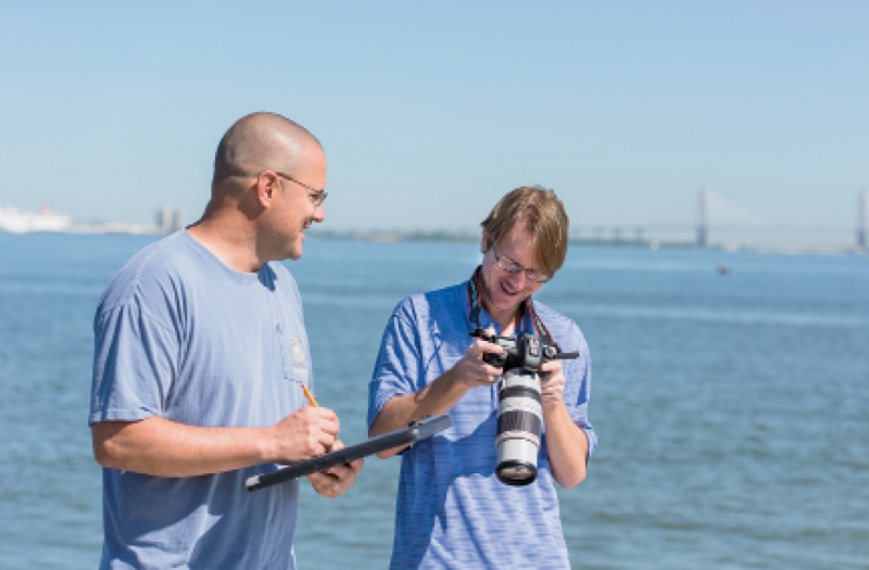 Eric Zolman and Todd Speakman (with camera) work to photo-ID and monitor our dolphin population.