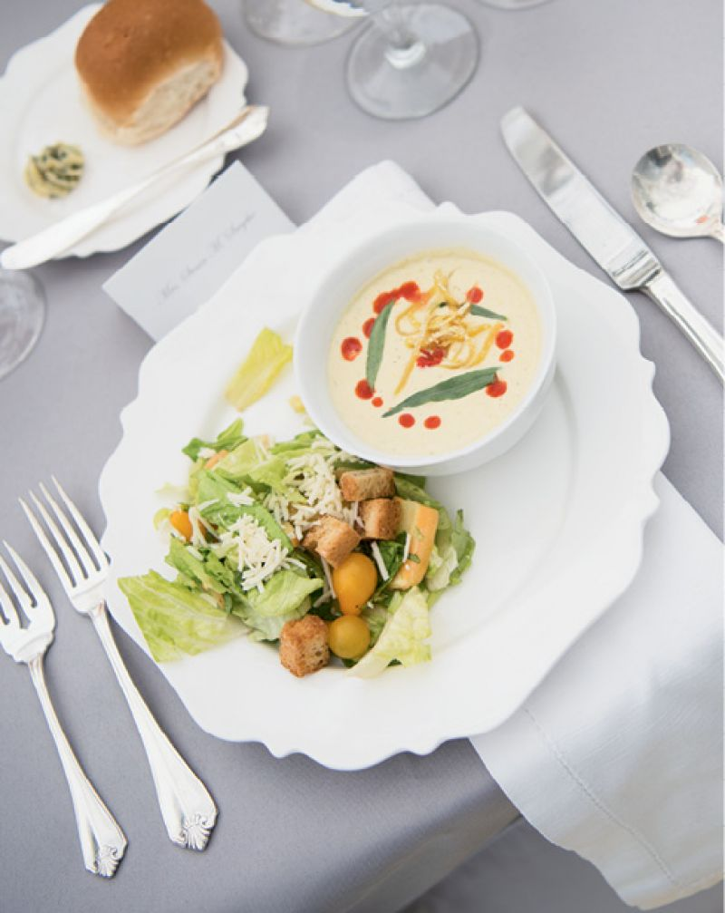 Caesar salad and chilled corn bisque served by Salthouse Catering