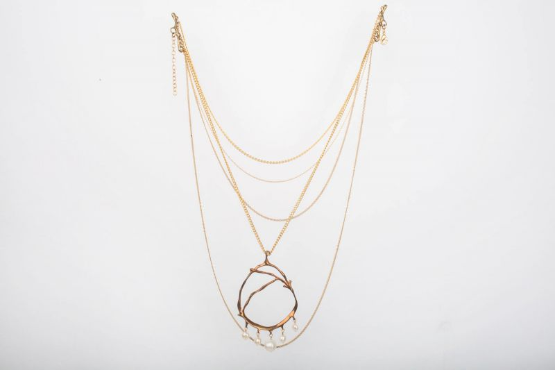 Roka 18K yellow gold and pearl five strand necklace, $158 at Out of Hand