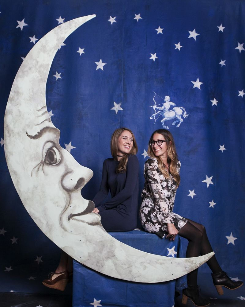 "Michelle Hurst and Lisa Roy pose in the signature ""Moon Booth."""