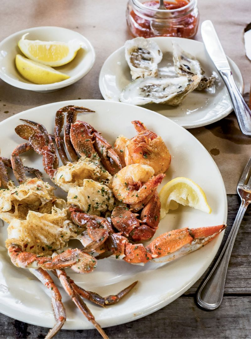 """""""Single Lady"""" oysters are served on the half-shell, along with crab and shrimp prepared in Albany's spicy, garlic-crab style."""