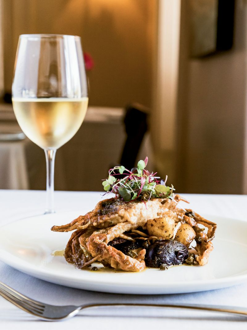 Sauteed soft-shell crab with lemon caper sauce at the Anchorage 1770's Ribaut Social Club