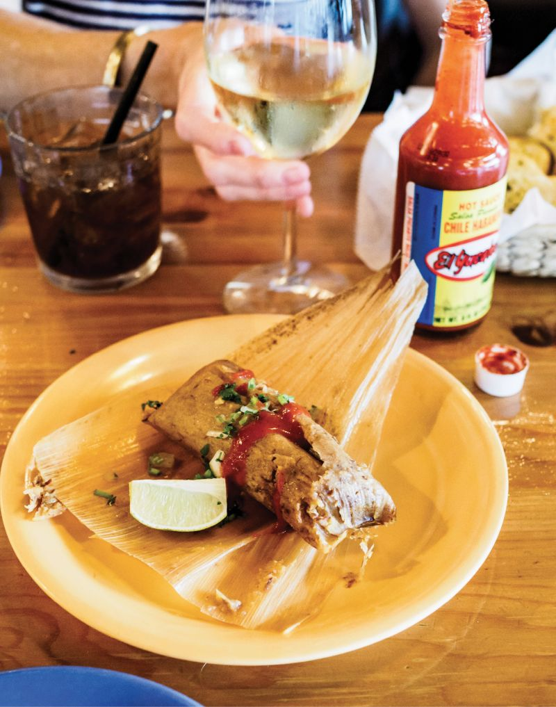 Unwrapping a tamale at Rancho Alegre