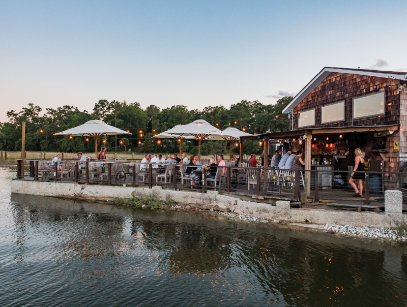 and the rustic waterfront scene at sunset—all at The Wyld.