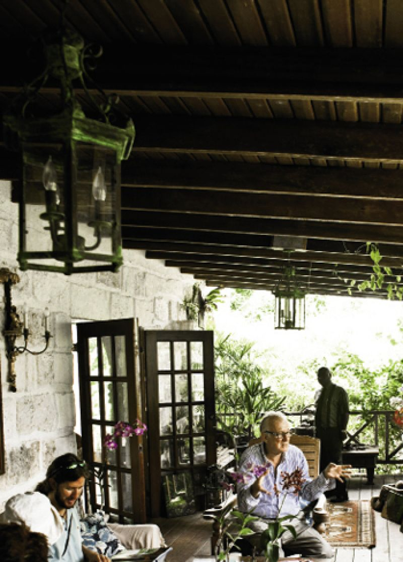 After touring the private garden pathways, visitors are invited to linger on the porch of Hunte's home for cocktails and conversation.