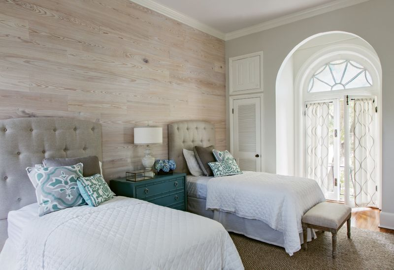 The guest bedroom features an accent wall of whitewashed cypress.